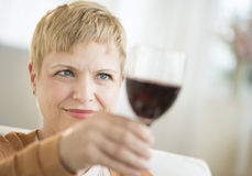 Woman Holding Up Red Wineglass Royalty Free Stock Photo
