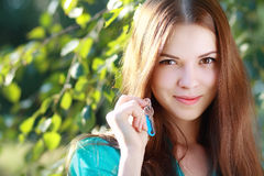 Woman holding up a set of keys Royalty Free Stock Images