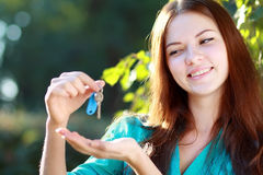 Woman holding up a set of keys Stock Image