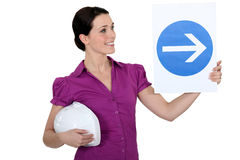 Woman holding up a sign Stock Photos