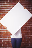 Woman holding up a white board Royalty Free Stock Photo