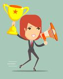 Woman holding up winning trophy and a megaphone Royalty Free Stock Photo