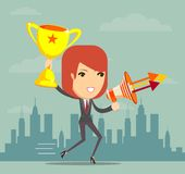Woman holding up winning trophy and a megaphone Stock Image