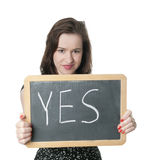 Woman holding up YES sign Royalty Free Stock Photo