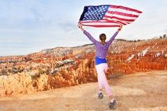 Woman holding US flag, Bryce Canyon National Park Stock Photos