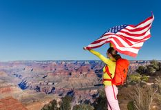 Woman holding US flag, Grand Canyon National Park Stock Image