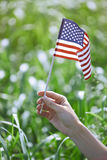 Woman holding US flag Stock Photo