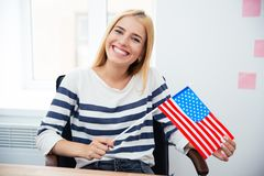 Woman holding US flag Stock Images