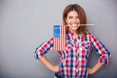 Woman holding USA flag in teeth Royalty Free Stock Images