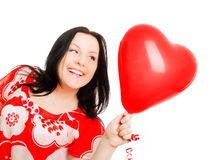 Woman holding valentine heart balloon over Stock Images