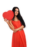 Woman holding Valentines Day heart sign Stock Photos