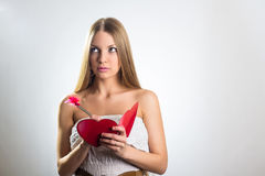 Woman holding Valentines Day heart sign Stock Photo