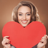 Woman holding Valentines Day heart sign with cop Stock Image