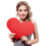 Woman holding Valentines Day heart sign Royalty Free Stock Image