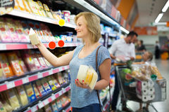 Woman holding variety of cheese. Cheerful women holding variety of cheese supermarket Stock Photography