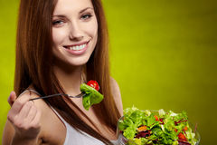 Woman holding vegetable salad on green backg Stock Photography