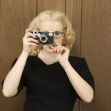 Woman holding vintage camera royalty free stock images