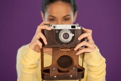 Woman holding a vintage film camera Stock Photography