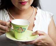 Woman holding vintage tea cup Stock Image
