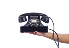 Woman Holding Vintage Telephone. A black vintage phone held by a female stock images