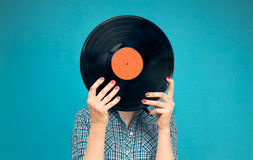 Woman holding a vinyl record Royalty Free Stock Photo