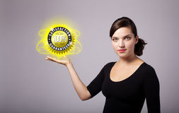 Woman holding virtual business sign Stock Photo