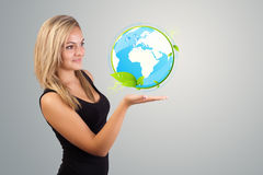 Woman holding virtual eco sign Royalty Free Stock Images