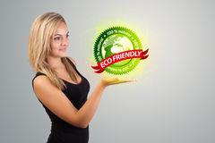 Woman holding virtual eco sign Stock Photos