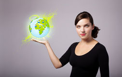 Woman holding virtual eco sign Royalty Free Stock Image