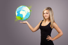 Woman holding virtual eco sign Royalty Free Stock Photos