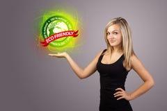 Woman holding virtual eco sign Stock Photo