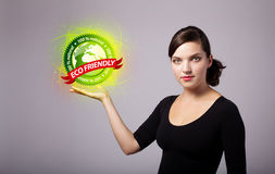 Woman holding virtual eco sign Stock Images