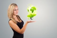 Woman holding virtual eco sign Stock Photography