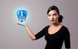 Woman holding virtual shield sign Royalty Free Stock Photo