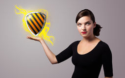 Woman holding virtual shield sign Royalty Free Stock Photography