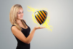 Woman holding virtual shield sign Stock Photo