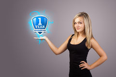 Woman holding virtual shield sign. Young woman holding virtual shield sign Stock Photo