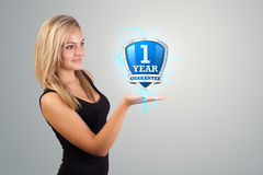 Woman holding virtual shield sign Royalty Free Stock Photo
