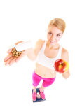 Woman holding vitamins and apple. Health care. Royalty Free Stock Images