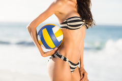 Woman holding volley ball Stock Image