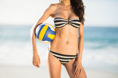 Woman holding volley ball Stock Photo