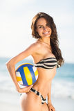 Woman holding volley ball. On a sunny day Stock Photo