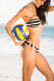 Woman holding volley ball Royalty Free Stock Image