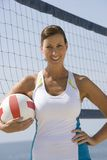 Woman Holding Volleyball At Beach Stock Photo