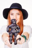 Woman holding voodoo doll Royalty Free Stock Images