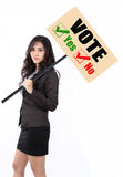 Woman holding vote sign. To calling people goto vote Stock Photography