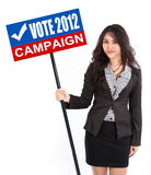 Woman holding vote sign. Business woman holding vote sign campaign to calling people election 2012 Royalty Free Stock Photography