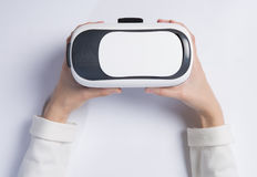 Woman holding VR headset Royalty Free Stock Photos