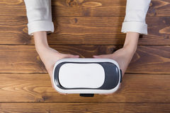 Woman holding VR headset Royalty Free Stock Photo