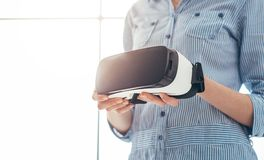 Woman holding a VR headset Stock Photo